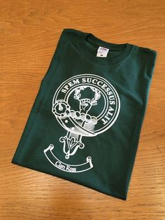 Green cotton t with Ross clan crest