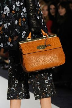 MULBERRY introduced a new handbag addition at its catwalk show on Sunday, in the form of the Suffolk – a ladylike doctor's bag that comes in teal, yellow, brown, black and navy.