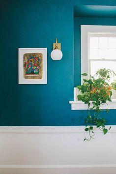 When not in direct light, Farrow & Ball's Vardo takes on deeper, bluer hues that look fantastically striking against bright white panelling. http://www.deterra-kitchens.co.uk/