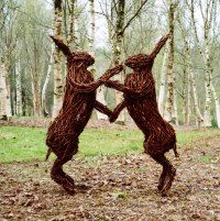 Steel and willow Hares and Rabbits sculpture by Alicia Castrillo titled: 'Boxing Hares (Big Outsize Mad Willow outdoor Garden or Yard statue...
