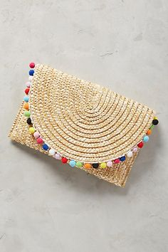 Shiraleah Pommed Straw Clutch. Chicago-based Shiraleah has been at the forefront of spotting accessories trends for over 25 years. Aiming to connect street style with classic functionality, they design each piece with a focus on elevated color palettes and premium mixed materials sourced from around the globe. (AD)