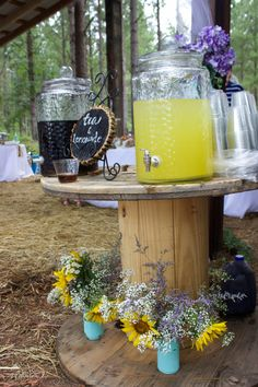 these spools made for great tables at the breakfast reception for my daughter's wedding in a sunflower field
