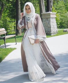 Nude abaya with white lace .