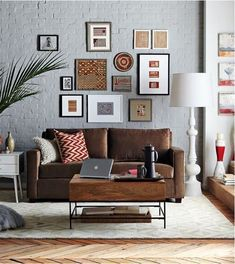Industrial Design Living Room Gray Walls - In the picture above, there is a brown sofa, a wooden table with a shelf underneath to store some books #industrialdesign #industrialdesignlivingroom #industrialdesignlivingroomgraywalls #industrial_design_living_room_gray_walls #industrialdesign_livingroom_graywalls