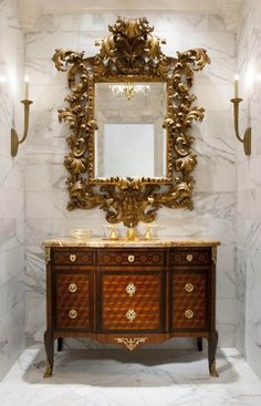White marble powder room with antique century French marquetry commode with gilt bronze mounts incorporated as the lavatory. The mirror is a century carved and gilded Italian antique.By Priory Home Atelier Beautiful Mirrors, Beautiful Bathrooms, Beautiful Pictures, Home Interior, Interior Decorating, Interior Design, Decorating Ideas, Decor Ideas, Classic Decor