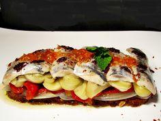 Escalibada con sardinas escabechadas