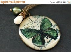 SUMMER SALE Green Butterfly Charm Necklace. Green Butterfly Necklace with White Coral Teardrop and Green Pearl. Butterfly Jewelry. Handmade by StumblingOnSainthood from Stumbling On Sainthood. Find it now at http://ift.tt/2tdyk0Y!