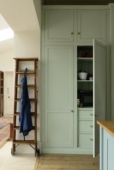 This is just one part of a huge bank of bespoke, handmade cupboards fitted in the York Townhouse. This particular one has deep shelves and drawers, the one next to it houses a huge pantry and the final one is the fridge and freezer. And it's all hidden behind these beautiful blue painted doors. This is why we love integrated appliances, it keeps the space feeling so simple and uncluttered, just as a kitchen should be.