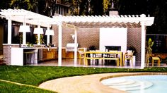Pergolas can nicely frame any outdoor cooking area.