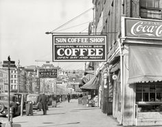 """December 1935. """"New Orleans, downtown street."""" North Front at Canal. Nitrate negative by Walker Evans for the Farm Security Administration"""