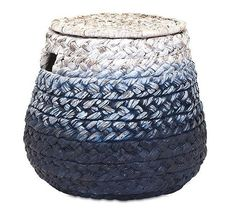 Our large woven blue storage bins with lids are handcrafted from water hyacinth and rattan for durability and artistic sensibility. The large braid pattern and carry cutouts create a storage basket me