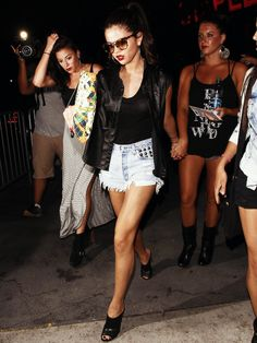 Selena Gomez.. Came across this photo and just look how gorgeous she is, just loving the heels, then nice toned legs ... Wow, looks hot, wearing sunglasses at night (only she could rock that) got her girls behind her HA go girl