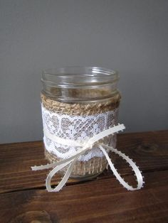 Mason jar candle holders wrapped with rustic burlap, lace, and ribbon - the perfect touch for that barn or country wedding, candlelight is so cozy and romantic! Mason Jar Candle Holders, Mason Jars, Burlap Lace, The Perfect Touch, Rustic Feel, Ribbon Colors, Rustic Wedding, Wedding Decorations, Barn