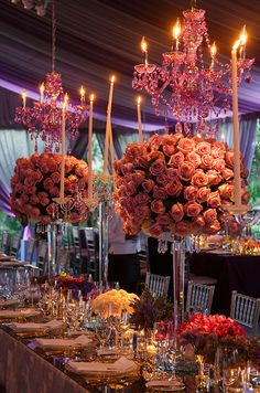 A purple chandelier serves as a chic focal point for this elegant wedding reception.