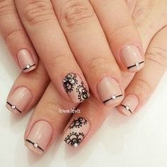 Elegant nails with single stiples and lace on nude base