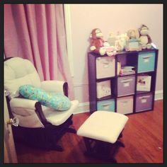 My daughters teal, pink, purple and grey nursery! I love the Martha Stewert storage solutions line! They can be found at Menards (so many cute colors, too). Design by J. Kennedy :)