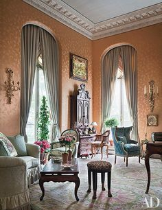 The ballroom of writer Aileen Mehle's Manhattan apartment has original crown moldings and a ceiling high enough to accommodate her prized Italian secretary. Mario Buatta decorated the residence, which is in a 1903 townhouse designed by Horace Trumbauer.