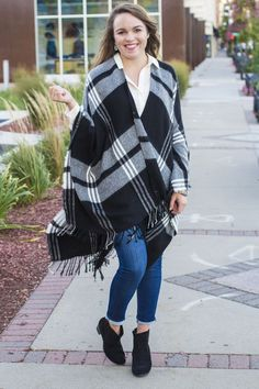 Who said fashion is pain? @tshoffman shows effortless (and comfy) style with this Target plaid poncho. It's a popular item this season because it's great for layering and can be paired with heavier sweaters and turtlenecks in the winter. The black and white plaid is also extremely versatile and will go well with so many other items.www.taymeetsworld.com/2015/09/mad-about-plaid-with-target.html