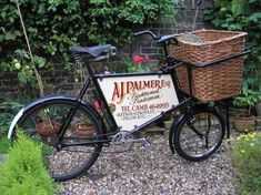 """Interesting front wheel and advertising - this would make a good book """"mobile"""" bicycle."""
