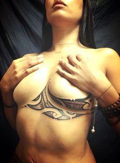 tribal sternum tattoo