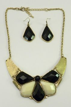 """Black and Ivory Petals make quite a statement in this brass necklace with tribal undertones. Necklace has lobster closure. Matching black petal hook earrings are included making this item an exceptional buy! This set will go from work to a night on the town with ease!    Measures: 18"""" chain; 3"""" extension   Black Ivory Necklace Set by Mimi's Gift Gallery. Accessories - Jewelry - Necklaces - Statement Necklaces Kentucky"""