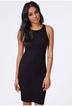 """This LBD is a layering dream. The basic ribbed jersey material and fierce bodycon fit makes this a total wardrobe necessity. Wear with ankle boots and a leather biker for that effortless day edge.  Approx length 84cm/33""""   95% Polyester..."""