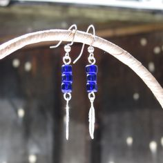 Blue Glass Beaded Earrings with Feather Charm | Minimalist Jewerly | Gifts under 10 | Dainty Earrings | Drop Earrings | Feather Earrings by MagnificentMouse on Etsy