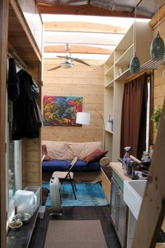 Nate and Jens Home on Wheels: This house has a lot of cool ideas such as the fiberglass roof to let in light. Raised door with storage underneath for shoes. A lot of thought went into this house.