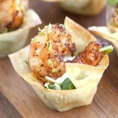 Chili Lime Shrimp Cups -   Baked wonton shells filled with chili-lime shrimp, arugula and sour cream