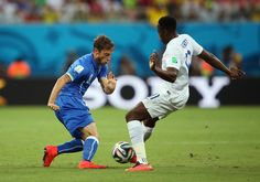 Danny Welbeck of England is challenged by Claudio Marchisio of Italy during the 2014 FIFA World Cup Brazil Group D match between England and Italy at Arena Amazonia on June 14, 2014 in Manaus, Brazil.