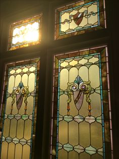 6' x 10' stain glass halfway up my staircase custom made in NYC Around 1900.