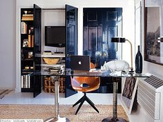 Nate Berkus used one of the closets for a media center & home office & painted the closet doors with High Gloss Black Paint + the glass table can be used as a desk or dining table. Painted Interior Doors, Black Interior Doors, Small Spaces, Interior, Home, Nate Berkus, Doors Interior, Interior Design, New York Apartment