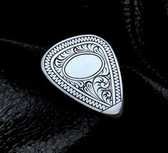 Engraved guitar pick by @androscreations. Hello, this is AWESOME!
