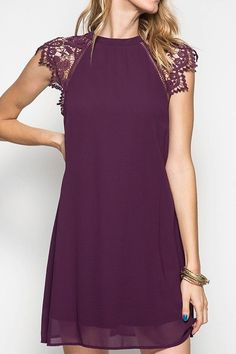 Solid self tie back dress with crochet cap sleeves and lining.