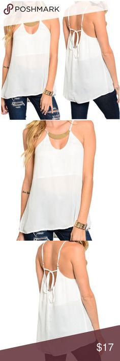White Spaghetti Strap Tank Top White Spaghetti Strap Halter top. Made of 100% polyester. Lining 100% polyester. Available in XS, S, M, L. NO TRADES. PRICE FIRM. BUNDLE 3+ items to save 15%!!!! Tops Tank Tops