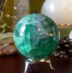 A personal favorite from my Etsy shop https://www.etsy.com/listing/471872377/beautiful-green-fluorite-sphere-crystal