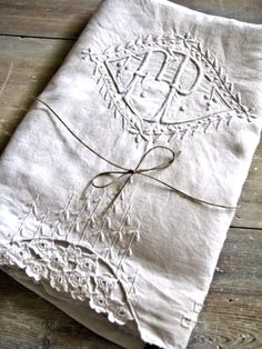 creamy white monogrammed bed linen - so sweet. Perfect for second sets? extra pillows?