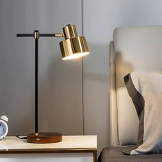 Brighten up your workspace with this desk lamp. Paired with gold shade and black frame, the table lamp gives an understated yet stylish look. It allows charging with USB port or phone case on that is suitable for all Qi-enable phones. Plus, the lamp will light up with a single touch for easy operation. Perfect for your living room, bedroom, study room, and more. There is a layer of film on the surface. Tear it off when using.- Materials: Metal, Solid Wood- Finish: Black&Gold- Overall Dimen Bedside Table Lamps, Desk Lamp, Lamp Table, Usb, Lampe Tactile, Study Lamps, Touch Lamp, Bed Lights, Black Lamps