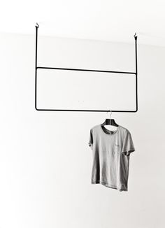 #minimalism #product #display #grey #tshirt #hanging #metal #frame #store #layout #inspiration #unisex #menswear