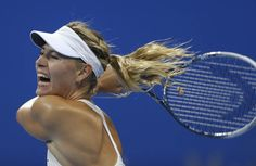 Maria Sharapova of Russia reacts as she prepares to return the ball during her women's singles tennis match against Carla Suarez Navarro of Spain at the China Open tennis tournament in Beijing, October 1, 2014. (REUTERS/Jason Lee)