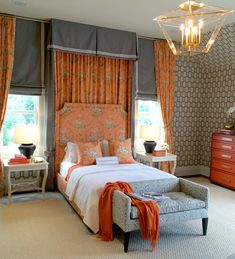 Love how orange really makes a statement in this bedroom - the patterns and textures, just beautiful!