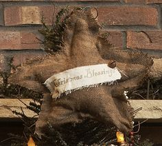 Primitive Christmas Blessings Tree Topper for sale. I think that this would be easy to make.  The tree that it is displayed on is a great inspiration.