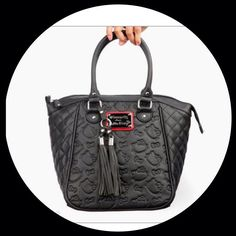 Black Hello Kitty bag from Loungefly..@EvonneMcMeans