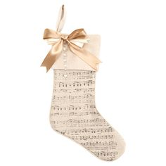 Bring a touch of nostalgia to your holiday mantel with this charming stocking, artfully crafted from a soft cotton-linen blend and adorned with a vintage-ins...