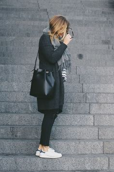 Grey alpaca scarf, bucket bag, Adidas sneakers.