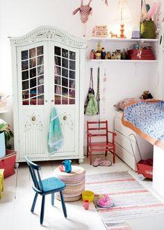 Painted wood floors, pretty wardrobe and rug.