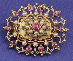 Victorian Anglo-Indian 15kt Gold Gem-set Brooch, set with rubies, emerald and seed pearls, 1 1/2 x 1 1/4 in