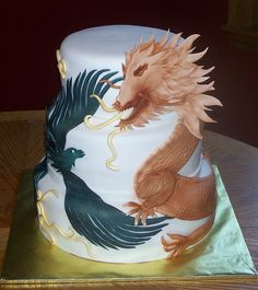 Dragon & Pheonix wedding cake  by The Enchanting Cake, via Flickr