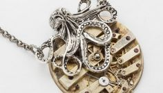 Steampunk Octopus Necklace featuring a key wind pocket watch displaying  it's gears and levers