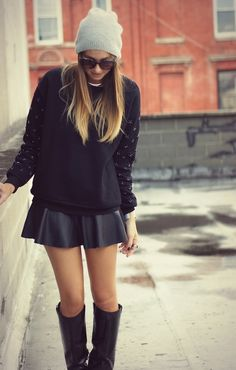 Adorable black sweater, skirt, long boots and woollen hat style for fall